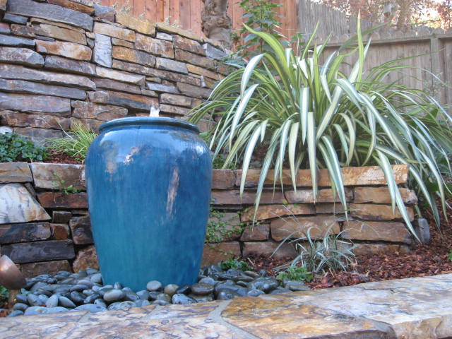 A water element creates visual and acoustic beauty in the garden. It can be  in the form of a simple overflowing urn or boulder or a sheet of water  trickling ...